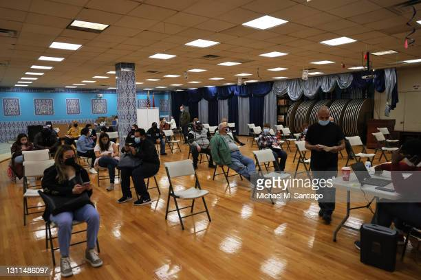 People sit in the waiting area to monitor for possible side-effects at the Northwell Health pop-up coronavirus vaccination site that administers the...