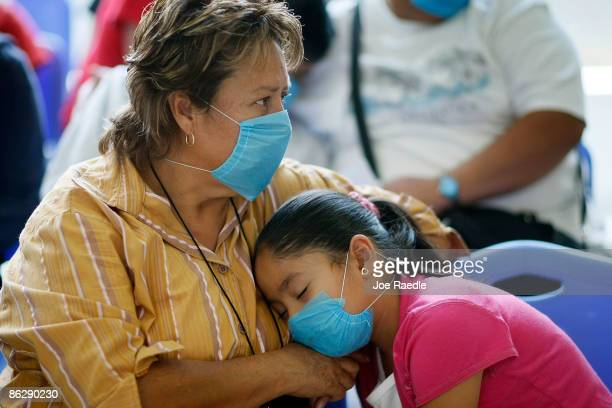 People sit in the waiting room at the Mexico City Navy Hospital to be checked for flulike symptoms on April 29 2009 in Mexico City Mexico Cases of...