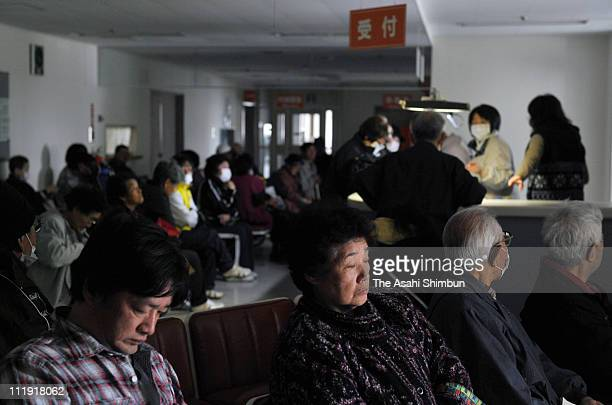 People sit in the waiting room because of the power outage after the strong aftershock at a hospital on April 8 2011 in Kamaishi Iwate Japan More...