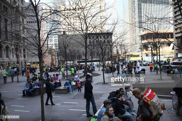 People sit in Zuccotti Park as supporters attend a a news conference and rally for New York City Council Members Jumaane Williams and Ydanis...