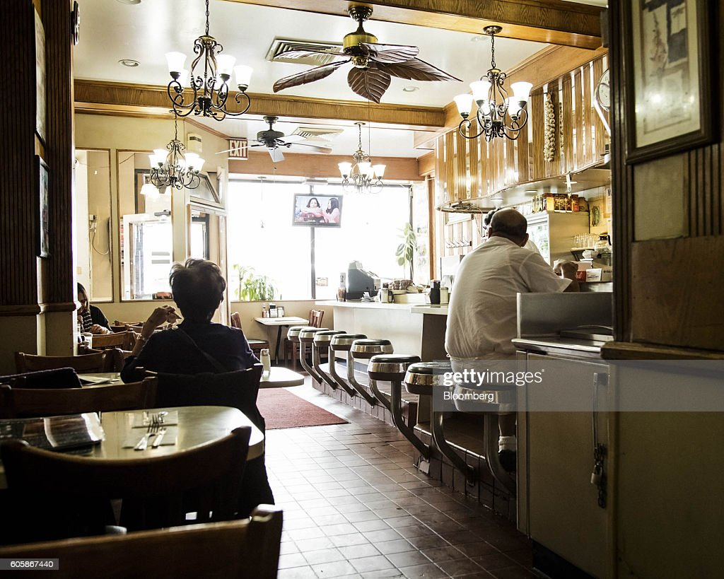 People sit inside Joe Jr. restaurant in New York, U.S., on Monday, April 18, 2016. Top chefs pick their all-time favorites, from burgers with fat, mid-rare patties dripping with juice to thin, crisp disks of beef smothered with cheese. These are the ones the true masters crave when they're off duty. Photographer: Eric Medsker/Bloomberg via Getty Images