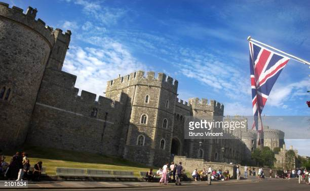 People sit near Windsor Castle the venue for Prince William's 21st birthday party June 21 2003 at Windsor Castle United Kingdom