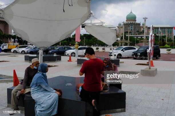 People sit on a bench near the Perdana Putra the office complex of the Prime Minister of Malaysia in Putrajaya Malaysia on Wednesday Sept 23 2020...