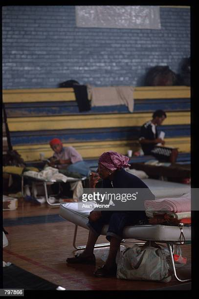 People sit on cots in a shelter September 27 1989 in South Carolina Hugo is ranked as the eleventh most intense hurricane to strike the US this...