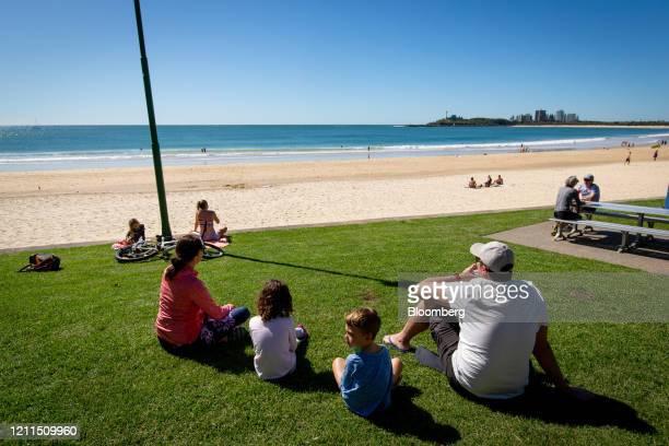 People sit on grass near Mooloolaba Beach in Mooloolaba, Australia, on Saturday, May 2, 2020. Australia's Prime MinisterScott Morrisonsaid the...