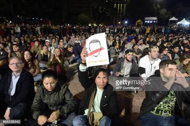 People sit on Plaza Catalunya square in Barcelona as they wait for polls results after the closing of polling stations on October 1 2017 Spanish riot...