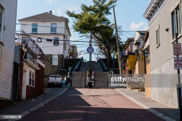 People sit on steps in West New York, New Jersey, U.S., on Friday, March 26, 2021. The U.S. Economy is on a multi-speed track as minorities in some...