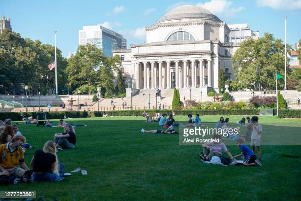 People sit on the grass at Columbia University as the city continues Phase 4 of re-opening following restrictions imposed to slow the spread of...