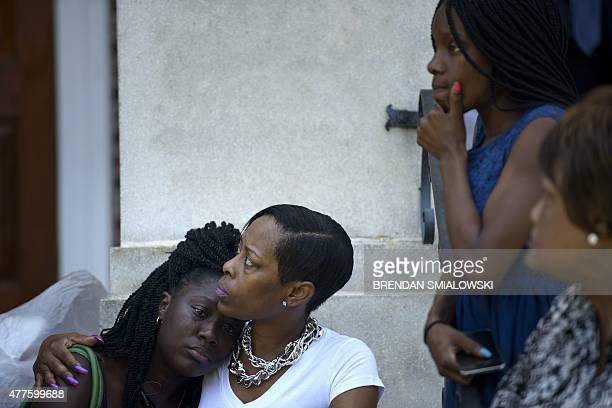 People sit on the steps of Morris Brown AME Church while services are held June 18 2015 in Charleston South Carolina US police on Thursday arrested a...