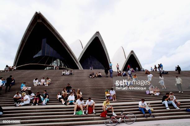 People sit on the steps of the Sydney Opera House