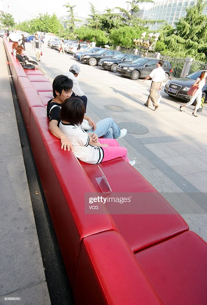 Beautiful People Sit On The Worldu0027s Longest Sofa In Front Of A Shopping Mall In On May