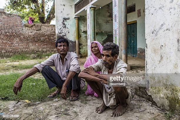People sit outside a house in in Sambhal Uttar Pradesh India on Monday Aug 22 2016 Prime Minister Narendra Modi's Hindunationalist Bharatiya Janata...