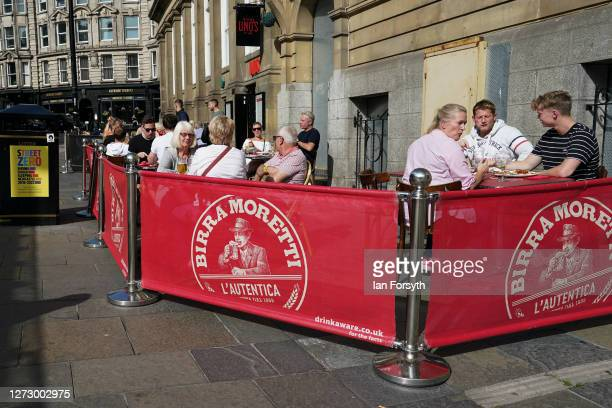 People sit outside a pub and restaurant near to the River Tyne on September 17 2020 in Newcastle upon Tyne England Almost two million people in...