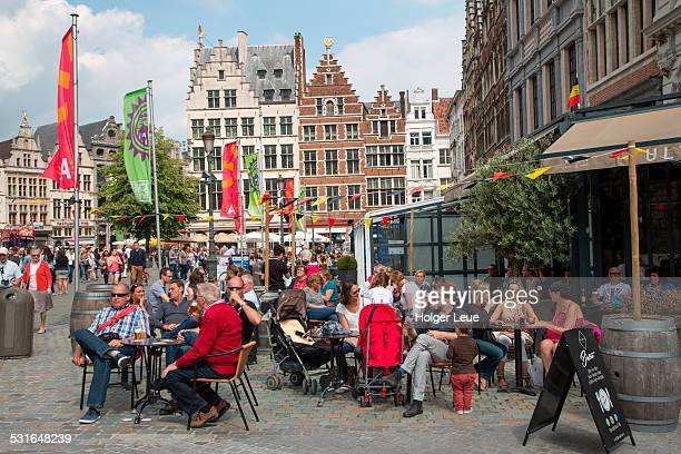 People sit outside bars & cafes at Grote Markt