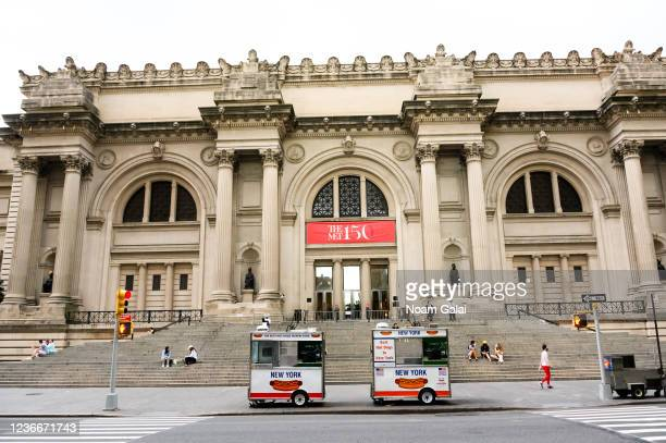People sit outside on the steps of the Metropolitan Museum of Art during the coronavirus pandemic on May 30 2020 in New York City Government...
