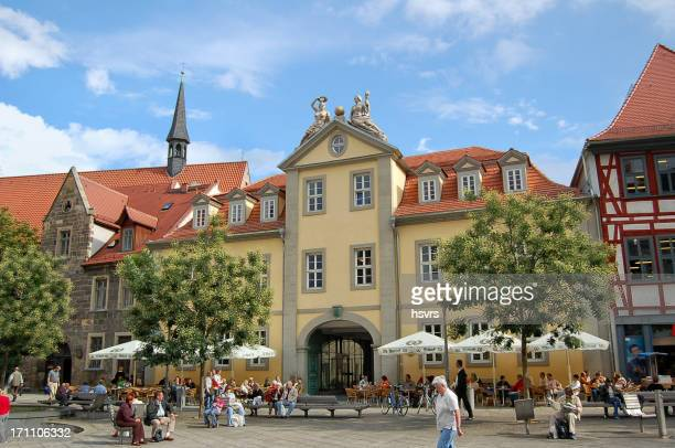 people sitting a restaurant at erfurt city (thuringia - germany) - essen germany stock pictures, royalty-free photos & images