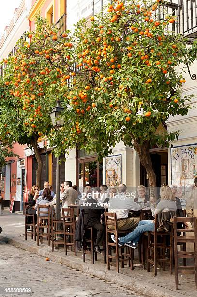 people sitting at a cafe in seville - seville stock pictures, royalty-free photos & images