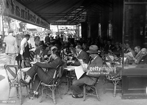 People sitting at a cafe terrace in September 1929 in Paris France