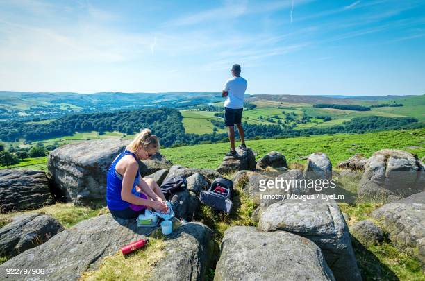 people sitting at landscape against sky - sheffield stock pictures, royalty-free photos & images