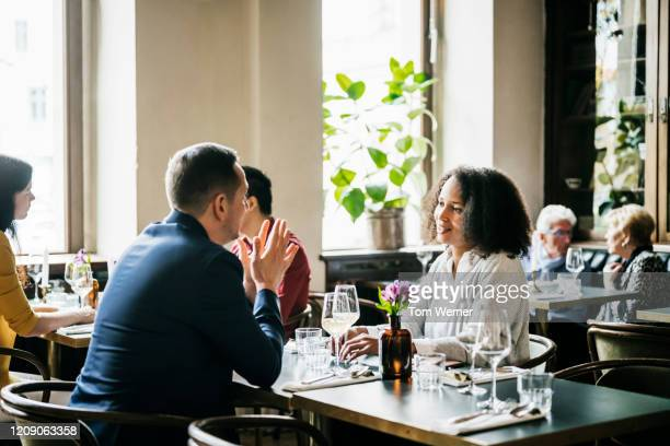 people sitting at restaurant tables for lunch - berlin stock pictures, royalty-free photos & images