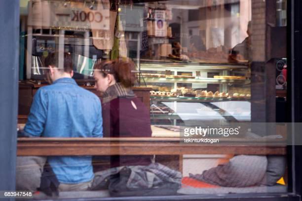 people sitting at restaurants in westend region of glasgow scotland england