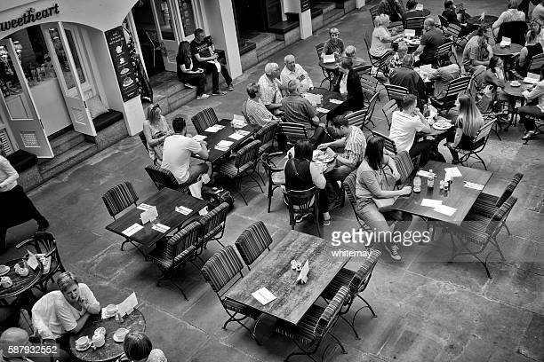 People sitting in a cafe in Covent Garden, London