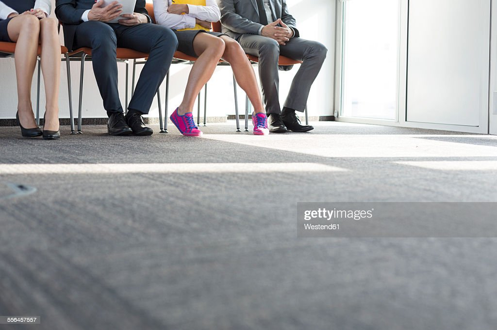 People sitting in a row, waiting for job interview : Stock Photo