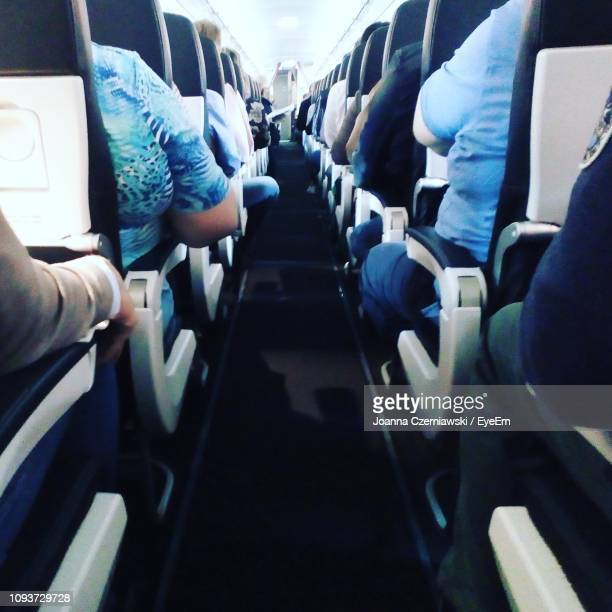 people sitting in airplane - joanna jet stock pictures, royalty-free photos & images