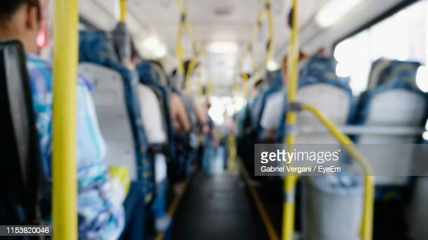 people sitting in bus - foco seletivo - fotografias e filmes do acervo