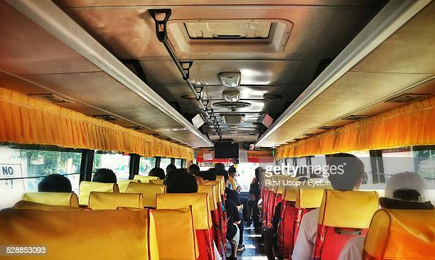 people sitting in bus - metro manila stock photos and pictures