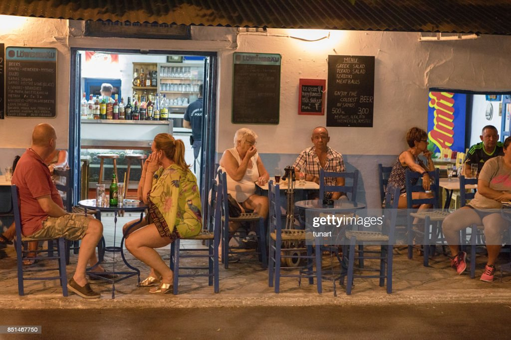 People Sitting in Front of a Pub in Pithagorio, Greece : Stock Photo