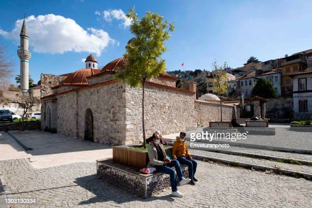 people sitting in front of namazgah bath building ,izmir. - emreturanphoto stock pictures, royalty-free photos & images