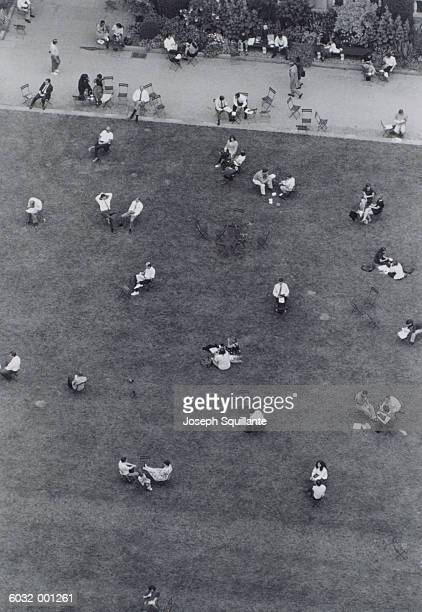 people sitting in park - joseph squillante stock pictures, royalty-free photos & images