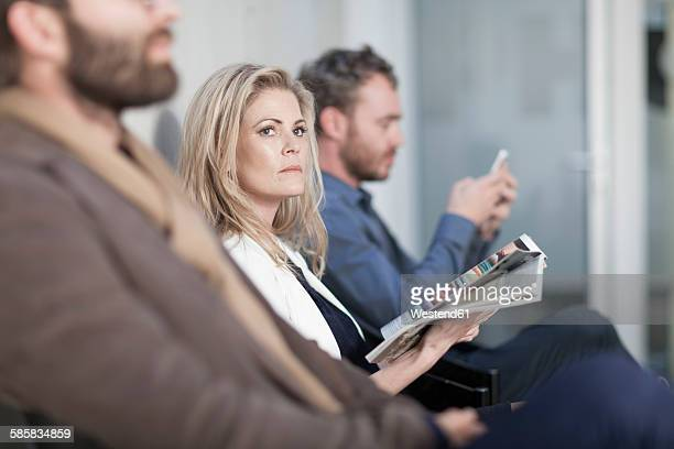 people sitting in waiting room - 20 24 years stock pictures, royalty-free photos & images