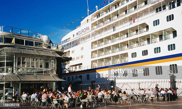 People sitting near MS Europa at Overseas Passenger Terminal.