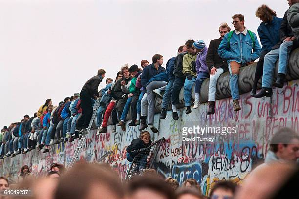 People Sitting on Berlin Wall