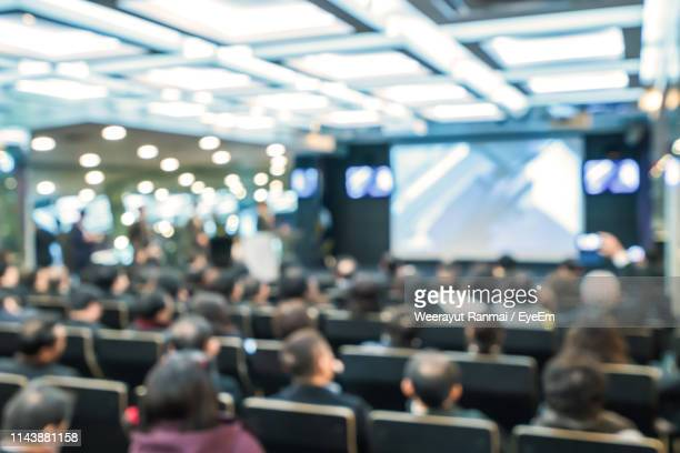 people sitting on chair in seminar - auditorium stock pictures, royalty-free photos & images