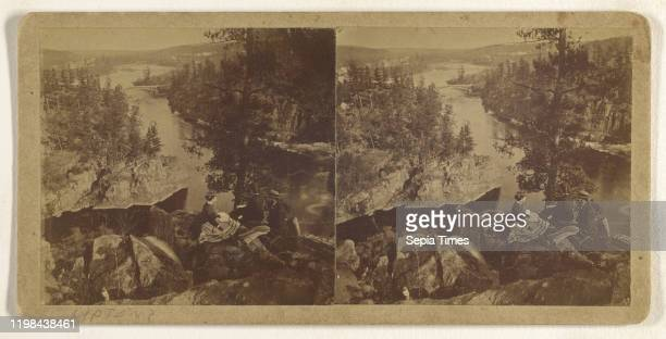 People sitting on rocks overlooking river with bridge in background Attributed to B F Upton 1865 1875 Albumen silver print