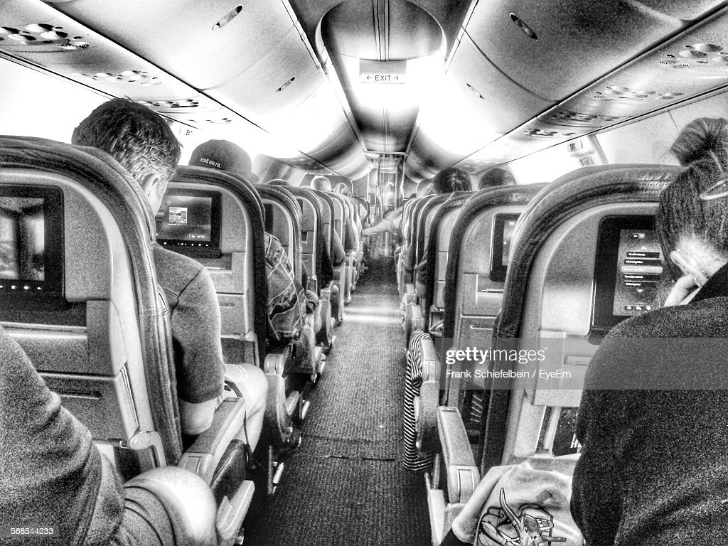 People Sitting On Seats In Airplane : Stock Photo