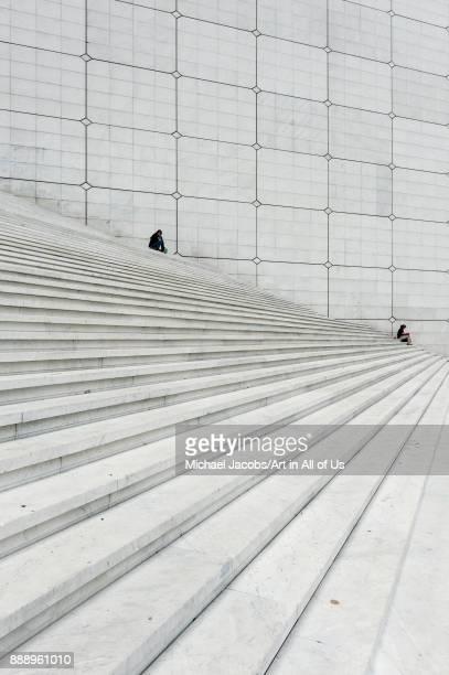 France Paris La Défense July 8 2011 people sitting on the stairs of the Grande Arche de la defense