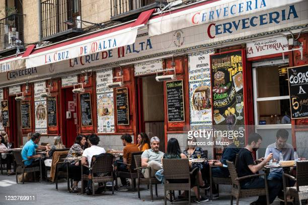 People sitting on the terrace of a bar in downtown Madrid during the last day of the State of Alarm for the COVID-19 pandemic. The Spanish government...