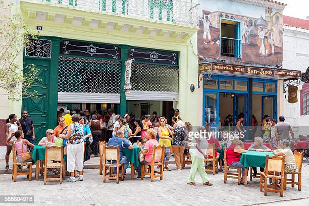 People Sitting Out and Having Lunch in Havana, Cuba