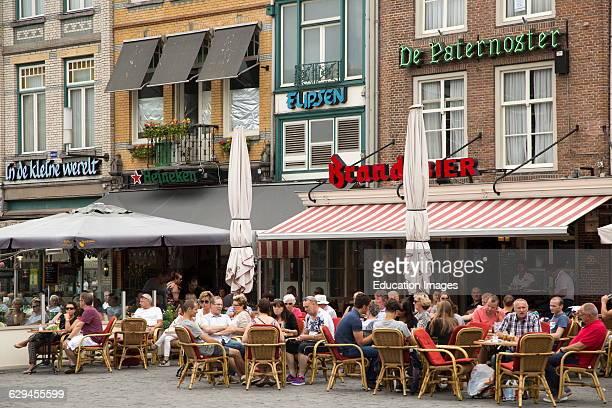 People sitting outside cafes in summer s-Hertogenbosch, Den Bosch, North Brabant province, Netherlands.