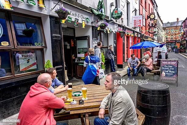 People sitting outside Irish pub in Wexford town centre