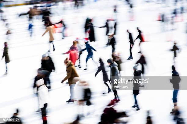 People skate at Central Park ice rink on Christmas day on December 25 2017 in New York City Security in New York is on alert as thousand of tourists...