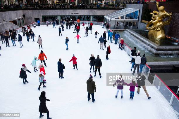 People skate at the ice skating rink at Rockefeller Center on Christmas day on December 25 2017 in New York City Security in the New York is on alert...