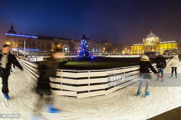 BRIEN People skate on a skating rink in a park in central Zagreb on December 19 2015 With an ice sculpture festival brass band fanfares and a huge...
