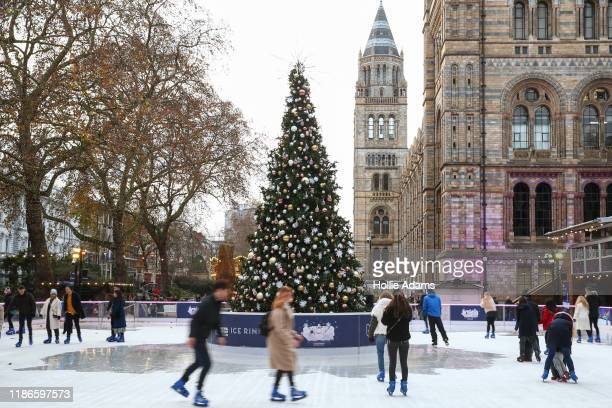 People skate on an ice rink at London's Natural History Museum of London on December 5, 2019 in London, England. The city hosts many holiday events...