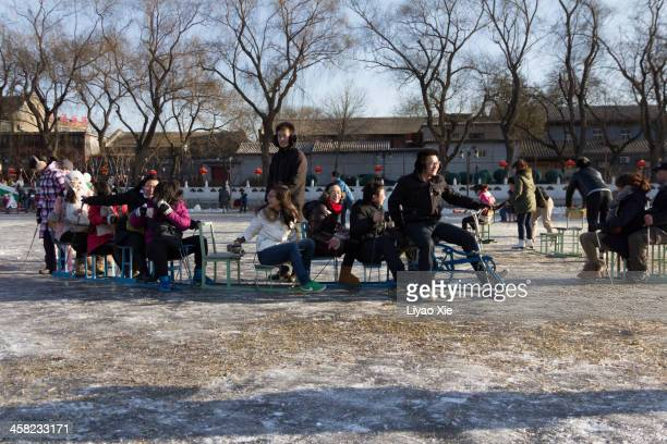 people skate on lake - liyao xie stock pictures, royalty-free photos & images