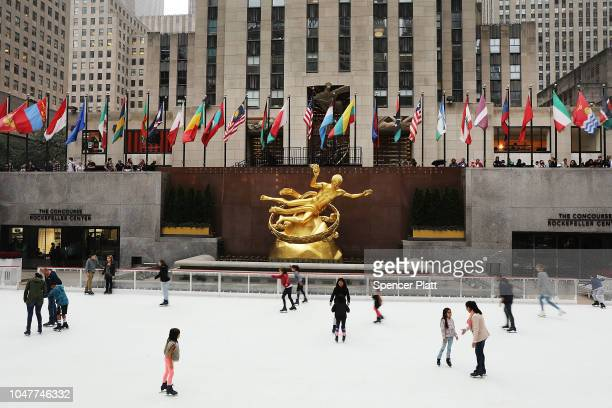 People skate on Rockefeller Center's ice rink on its opening day of the season on October 8, 2018 in New York City. The historic ice rink, which will...